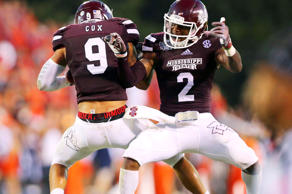 Mississippi State Bulldogs defensive back Will Redmond (2) and Mississippi State Bulldogs defensive back Justin Cox (9) celebrate after a reception during the game against the Auburn Tigers at Davis Wade Stadium Oct 11, 2014; Starkville, MS.