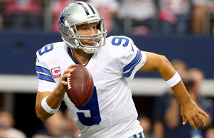 Tony Romo #9 of the Dallas Cowboys looks to pass against the Houston Texans in t...