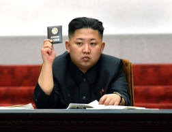 North Korean leader Kim Jong-Un holds up his ballot during the fifth session of the 12th Supreme People's Assembly of North Korea at the Mansudae Assembly Hall in Pyongyang, on April 13, 2012, in this picture released by the North's KCNA on April 14, 2012.