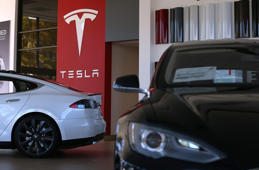 Tesla Model S cars are displayed at a Tesla showroom