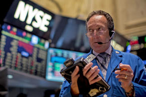 <p>A trader works on the floor of the New York Stock Exchange.</p>