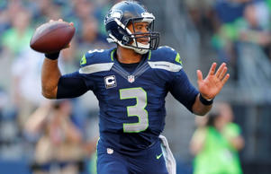 Seattle Seahawks quarterback Russell Wilson in action against the Denver Broncos in the second half of an NFL football game, Sunday, Sept. 21, 2014, in Seattle.