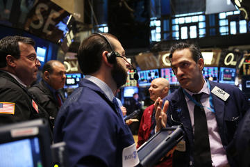 Traders work on the floor of the New York Stock Exchange (NYSE) on October 10, 2014 in New York City.