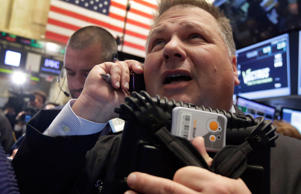 Trader George Ettinger works on the floor of the New York Stock Exchange on Monday.