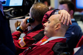 A trader watches the screen in his terminal on the floor of the New York Stock Exchange in New York October 15, 2014.