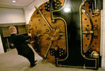 A Wells Fargo employee closes the door to the bank vault at a Wells Fargo bank after a news conference announcing the Wells Fargo vSafe, a personal online safe, in San Francisco, Wednesday, Oct. 1, 2008. (AP Photo/Jeff Chiu)