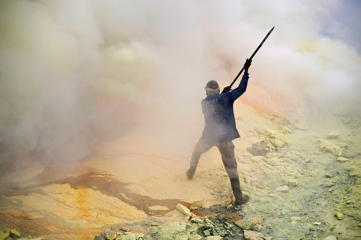 There are 130 active volcanoes in Indonesia, which have sporadically erupted since 2010 after being dormant for 400 years.  In Indonesia's East Java province, the Ijen crater is filled with one of the largest sulphuric lakes on the planet. Photographer Angel Navarrete has captured the lives of the miners collect sulphur from this active volcano.  Working under hazardous conditions, the sulphur is sold to local factories where it is used to refine sugar, make matches and medicines. In a single day, a miner in Ijen can haul up to 100kg of sulphur, earning an average of $6 per day.