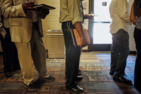 Job seekers wait in line to speak with recruiters at the Career Choice Inland Em...