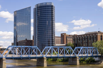 Grand Rapids is a city in the U. S. state of Michigan. The city is located on the Grand River about 25 miles east of Lake Michigan. It is second largest city in Michigan (after Detroit), and the largest city in West Michigan. Grand Rapids is home to five of the world's leading office furniture companies and has as one of its nicknames Furniture City. The city and surrounding communities are economically diverse, and contribute heavily to the health care, information technology, automotive, aviation, and consumer goods manufacturing industries, among others.