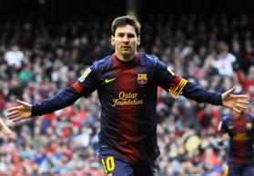 FC Barcelona's Lionel Messi of Argentina, celebrates after scoring during their Spanish League soccer match against Athletic Bilbao, at San Mames stadium in Bilbao, northern Spain, Saturday, April 27, 2013.