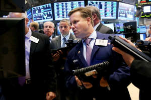 Traders work on the floor of the New York Stock Exchange on August 18, 2014 in New York City. Despite a number of global emergencies, the Dow shot up 175 points today, one of the largest single-day rises this year.