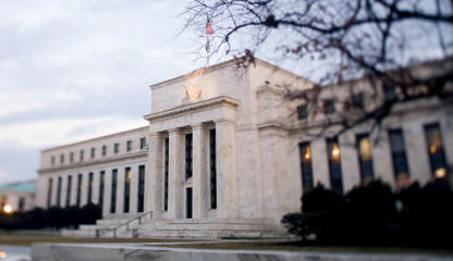 The Marriner S. Eccles Federal Reserve building stands in Washington, D.C., in this photo taken with a tilt shift lens in U.S., on Tuesday, Jan. 29, 2013. Federal Reserve Chairman Ben S. BernankeÕs latest round of bond buying will reach $1.14 trillion before he ends the program in the first quarter of 2014, according to median estimates in a Bloomberg survey of economists.