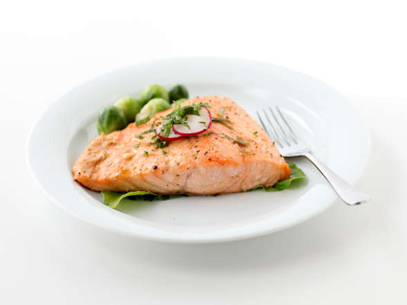 "When the going gets tough, Palinski-Wade suggests enjoying a grilled, baked, or poached salmon dish. ""This fish is a great source of omega-3 fatty acids,"" she says. ""Not only do these fatty acids decrease inflammation, but they have also been found to prevent stress hormones, such as cortisol, from peaking after a tense situation."" A study conducted by French scientists concluded that fish oil ""significantly blunted"" stress hormones exerted by the central nervous system."