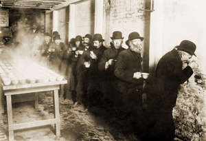 United States, World Giving Index, Bowery Mission: Depression of 1907-8 caused widespread hardship. These well groomed, prosperous looking men are in line at a Bowery Mission for free coffee for unemployed. 1908.