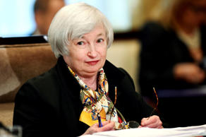 Federal Reserve Chairwoman Janet Yellen listens during a meeting of the Board of Governors of the Federal Reserve System at the Federal Reserve in Washington, Wednesday, Oct. 22, 2014.