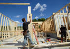 Workers frame a new home in the Allen Acres subdivision in Gorham, Maine.