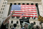 Occupy Wall Street activists pass in front of the New York Stock Exchange while they take part in a march in downtown Manhattan in New York July 11, 2012. REUTERS/Eduardo Munoz