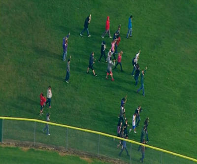 This image made from a video provided by KOMO shows student walking as emergency personnel respond after reports of a shooting at Marysville-Pilchuck High School in Marysville, Wash., Friday, Oct. 24, 2014.