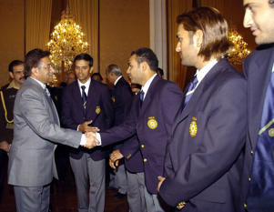 Then Pakistani President Pervez Musharraf shakes hands with Indian cricket player Virender Sehwag, as then team captain Rahul Dravid, Mahendra Singh Dhoni and Irfan Pathan look on during the Indian team's meeting with the President at his office in Islamabad February 10, 2006.
