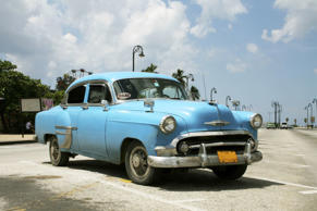 A classic car in the streets of Cuba.