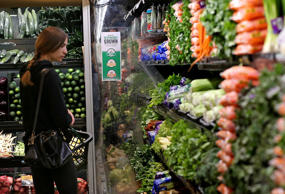A customer shops for produce at a Whole Foods market on October 15, 2014 in San Francisco, California.