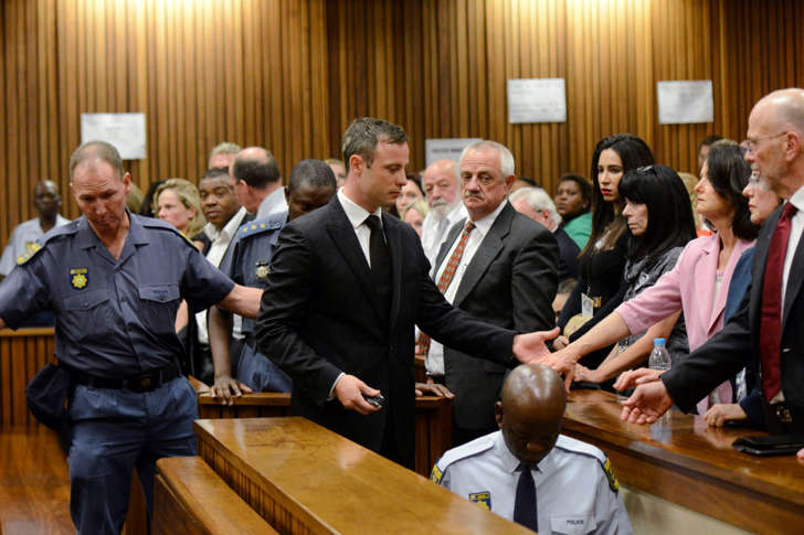 Oscar Pistorius meets his family members after being sentenced at the North Gauteng High Court in Pretoria, South Africa, Oct. 21, 2014.