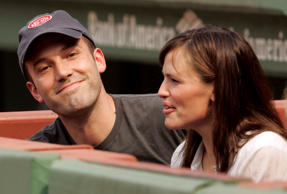 Actors Ben Affleck (L) and Jennifer Garner take their seats before the MLB American League baseball game between the Red Sox and the New York Yankees at Fenway Park in Boston, Massachusetts, June 2, 2007. Brian Snyder/Reuters