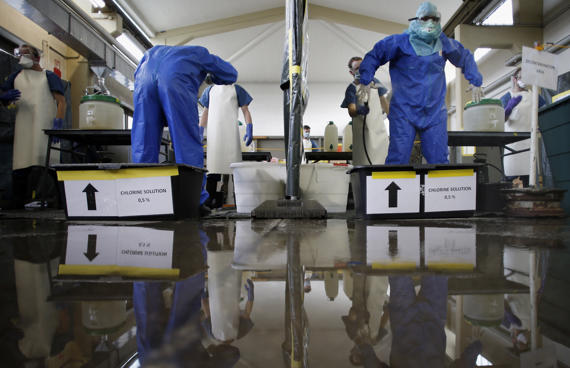 Volunteers who responded to a nationwide appeal by the German Red Cross (DRK) to help in the fight against ebola in Africa get decontaminated during training at the Bundeswehr facility.