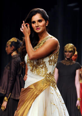 Sania Mirza showcases a creation by designer Shantanu & Nikhil during the Aamby Valley India Bridal Fashion Week 2013 in Mumbai on late December 2, 2013.
