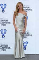 Amanda Holden looks stunning in long silver gown during charity.