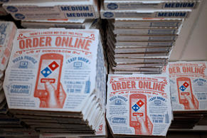 Dominos Pizza boxes with online ordering instructions are stacked at a Domino;s Pizza location in Murray, Ky.