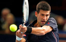 Serbia's Novak Djokovic returns the ball to German Philipp Kohlschreiber during their first round match at the ATP World Tour Masters tennis tournament at Bercy stadium in Paris, France, Tuesday, Oct. 28, 2014. Djokovic won 6-3, 6-4.