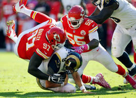 St. Louis Rams quarterback Austin Davis (9) is sacked by Kansas City Chiefs defensive end Allen Bailey (97) and linebacker Dee Ford (55) in the second half of an NFL football game in Kansas City.