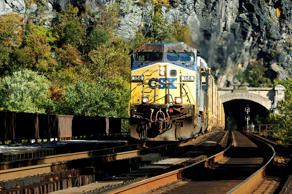 A CSX freight train heads westbound out of a tunnel into Harpers Ferry, West Virginia October 16, 2012. U.S. railroad CSX Corp reported a lower quarterly profit as lower domestic coal shipments offset growth in export coal and automotive shipments. Net income fell 2 percent to $455 million, or 44 cents per share, in the third quarter from $464 million, or 43 cents per share, a year before. The higher per-share figure reflected a stock buyback, CSX said.