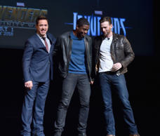 LOS ANGELES, CA - OCTOBER 28:  Actors Robert Downey Jr. (L), Chadwick Boseman (M) and Chris Evans onstage during Marvel Studios fan event at The El Capitan Theatre on October 28, 2014 in Los Angeles, California.  (Photo by Alberto E. Rodriguez/Getty Images  for Disney)