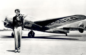 Amelia Earhart  in front of the Lockheed Electra in which she disappeared in 1937.