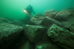In this photo released by Franck Goddio/Hilti Foundation, a diver inspects limestone blocks that form part of the ruins of the Temple of Isis on the royal island of Antirhodos, on the seabed of the harbor of Alexandria, Egypt, Tuesday, May 25, 2010. An international team of archaeological divers led by French underwater archaeologist Franck Goddio is using advanced technology to explore the submerged ruins of a palace and temple complex from where Queen Cleopatra ruled, painstakingly excavating one of the richest underwater archaeological sites in the world and retrieving stunning artifacts from the last dynasty to rule over ancient Egypt before the Roman Empire annexed it in 30 B.C.