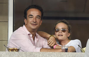 Olivier Sarkozy and Mary-Kate Olsen at the 2014 US Open in New York City, in September.