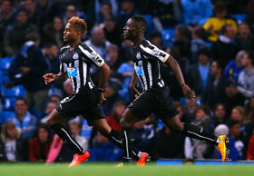 Newcastle United's Rolando Aarons (left) celebrates his goal against Manchester City with Massadio Haidara during their English League Cup fourth round soccer match at the Etihad Stadium in Manchester, northern England October 29, 2014.