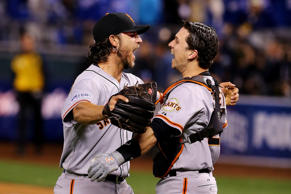 Buster Posey and Madison Bumgarner of the Giants celebrate after defeating the Royals to win game seven of the 2014 World Series.