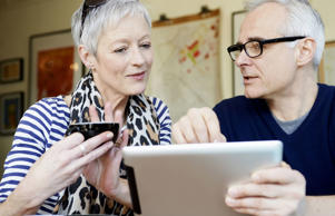 Retirees look at their expenses uses a digital tablet.