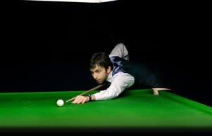 File: India's Pankaj Advani eyes the ball to play a shot in timed format match against Prem Prakash, unseen, at IBSF World Billiards Championship in Bangalore, India, Saturday, Sept. 6, 2008. The ten-day event started Monday have matches in two different formats.