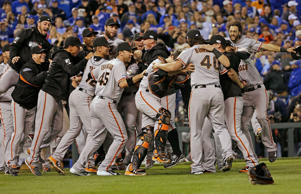 The San Francisco Giants celebrate after Game 7 of baseball's World Series against the Kansas City Royals, Wednesday, Oct. 29, 2014, in Kansas City, Mo. The Giants won 3-2 to win the series.