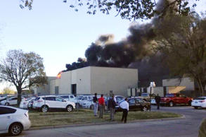 In the image from video provided by KAKE News, black smoke billows from a building at Mid-Continent Airport where officials say a plane crashed Thursday, Oct. 30, 2014 in Wichita, Kan.