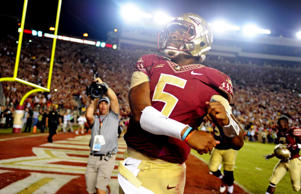 Florida State Seminoles quaterback Jameis Winston celebrates after beating the Notre Dame Fighting Irish 31-27 at Doak Campbell Stadium on Oct. 18, 2014 in Tallahassee, FL.