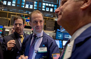 Traders work on the floor of the New York Stock Exchange on October 30, 2014.