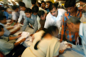 File: Tax payers line up to submit their income tax returns on the last day of filing in New Delhi.