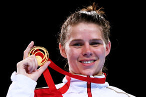 Gold medalist Savannah Marshall of England poses during the medal ceremony for the Women's Middle (69 - 75kg) Final at the Glasgow 2014 Commonwealth Games