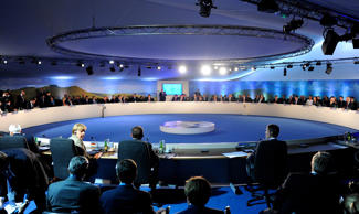 A general view of the round table, including German Chancellor Angela Merkel, at the NATO Summit on September 4, 2014 in Newport, Wales. Leaders and senior ministers from around 60 countries are gathering for the two day meeting where Ukraine and the ISIS hostages are likely to be discussed.
