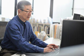 File photo of an older man working at his computer.
